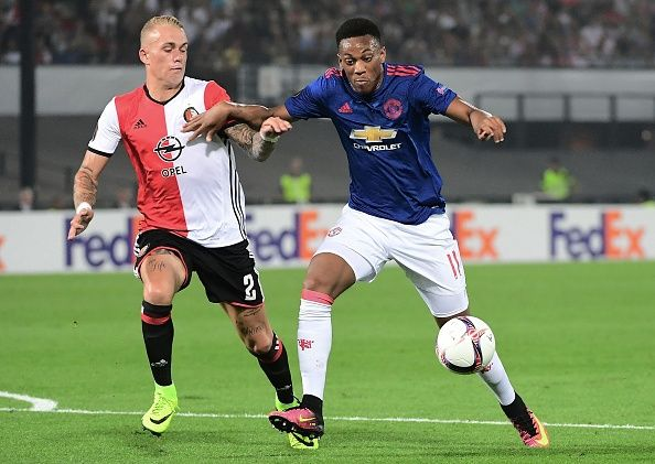 Feyenoord's Rick Karsdorp vies with Manchester United's Anthony Martial during…