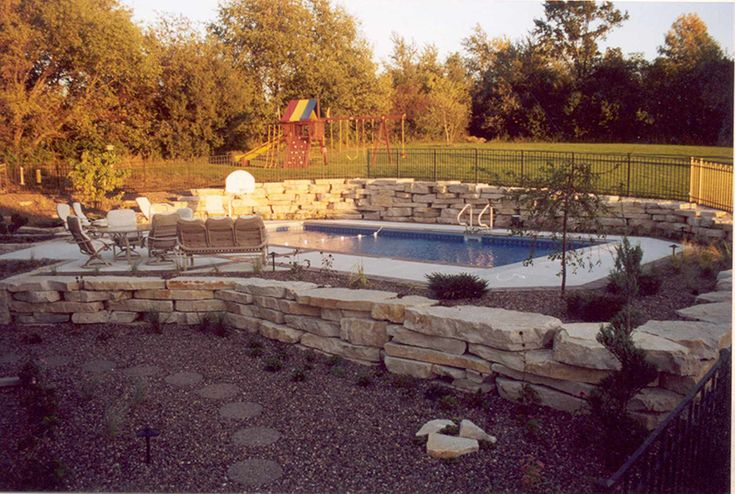 Retaining wall pool pinterest for Pool design retaining wall