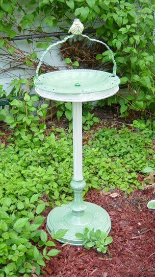 a birdbath made from an old cast iron ashtray...love