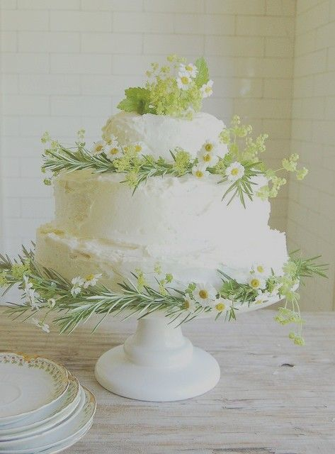 Daisy Wedding Cake. or herbal tea cake? it has chamomile blossoms, rosemary and dill?  great garden tea centerpiece