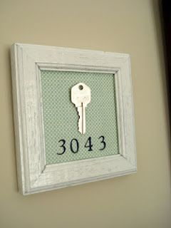 Cute idea to remember your first home. You could also put hooks in the bottom and let it double as a keyholder, and you could add keys from all your houses as you move.
