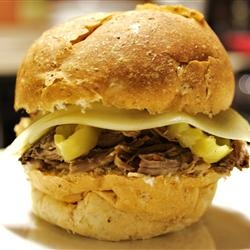 Italian Roast. Cook on low for at least 12 hours, shred, and serve with sliced Colby Jack and hamburger buns. Yum!