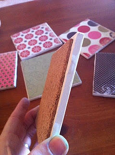 easy tile coasters  (16 cents a piece at Lowes + hot glue + thin roll of cork at JoAnns + Matte Mod Podge + scrapbook paper + Valspar Clear Flat Sealer spraypaint)