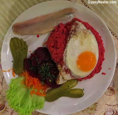 Would you eat it? Labskaus is mashed potatoes, corned beef, onions, beets, cucumber, egg and - wait for it - a herring fillet!