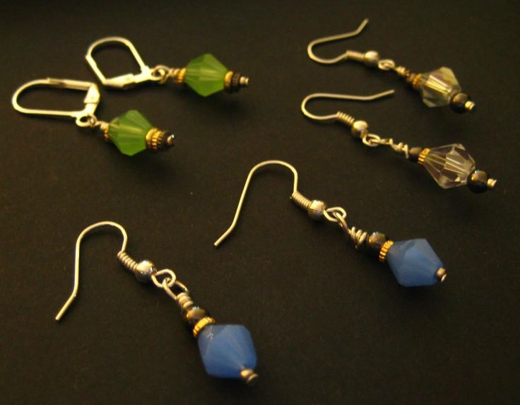 Three Pair Earring Set - 	 What a great way to increase your earring inventory! You get three pair of earrings with your order, with blue, green, and clear plastic bicone shaped stones. Silver plated metals. Two pair with fishhook earring hooks, and two with leverback.  $1.99 available at http://www.beaddesignsbysandy.com/shop/clearance-items/