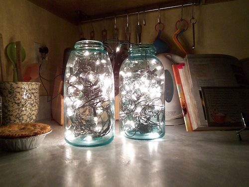 Pretty - I have lights like this in glass vases. In the vases, I put sea glass that I picked up at the craft store. Green, blue and white sea glass. It diffuses the brightness a bit, and the colors are beautiful. ;)