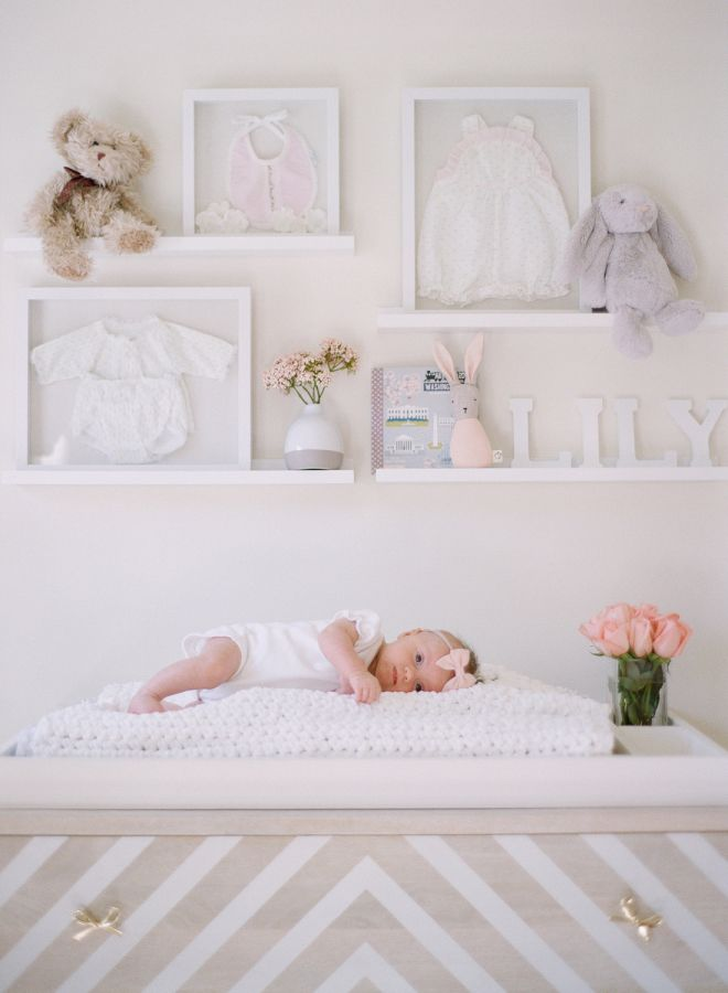 baby girl in her new blush nursery: http://www.stylemepretty.com/living/2016/12/02/a-blushing-baby-nursery-as-pretty-as-they-come/ Photography: Audra Wrisley - http://audrawrisley.com/
