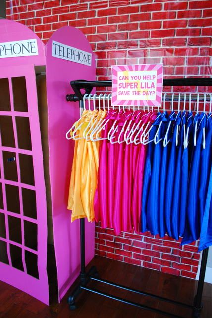 Capes and phone booth at a Girl Superhero Party #girlsuperhero #party