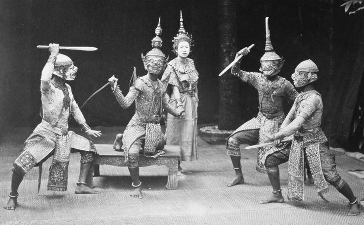 Bangkok:  Hanuman, the sacred white monkey guardian of Rama and Sita, threatens a group of demons in a Khon masked dance performance.
