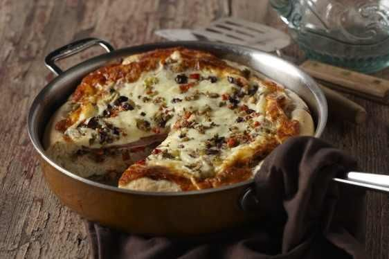 I found this recipe for New Orleans Muffuletta Pizza , on Breadworld.com. You've got to check it out!