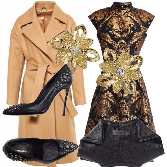 Cappotto cammello con cintura sulla vita, abito nero con ricami oro orientali, décolleté nere con borchie, borsa in pelle martellata ed orecchini che ricordano un fiore. Consiglio un acconciatura raccolta per lasciar libero il collo.