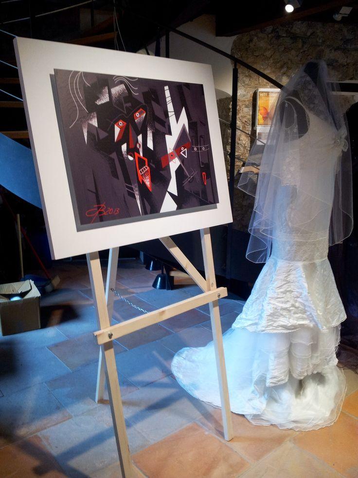 L'opera di digital painting by #BUCA dal titolo VOLTI, selezionata ed esposta alla Triennale delle Arti visive di Roma 2014, ora in mostra nella sala superiore del Castello