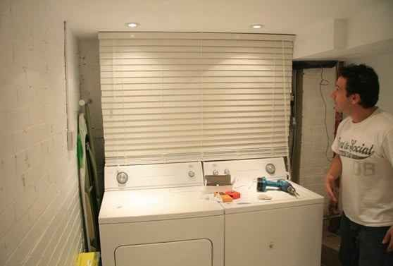 Hide unsightly pipes in the basement behind mini-blinds. | 42 Ingeniously Easy Ways To Hide The Ugly Stuff In Your Home