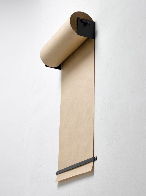 Ditch the bulky easel and hang paper on the wall. | 49 Clever Storage Solutions For Living With Kids