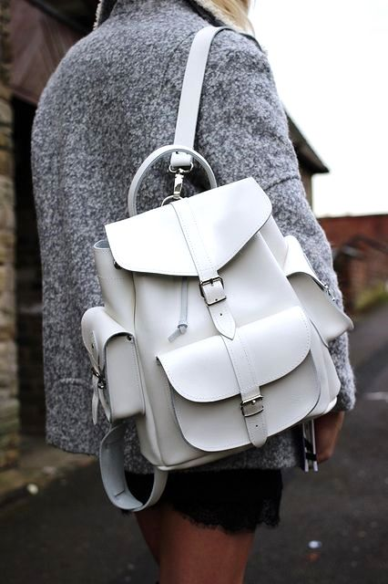 A white leather backpack is all you'll need for the upcoming Spring getaways.