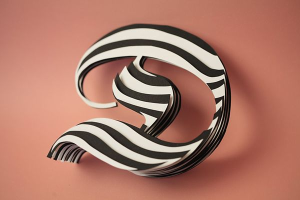 Paper letter constructions by Jerome Corgier. An almost complete alphabet is here at http://www.beautifullife.info/art-works/beatiful-paper-letters-by-jerome-corgier/