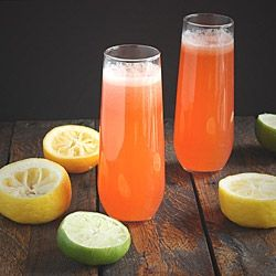 Spiked Strawberry Limonade Spritzers - sparkling vodka drinks with strawberries and fresh lemon and lime juice.