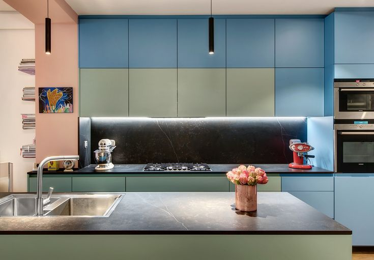Architect Alessandra Pisi Design Joncoux's latest interior design project is a loft created by uniting two smaller apartments, in colours inspired by the early twentieth-century Modernist Movement.