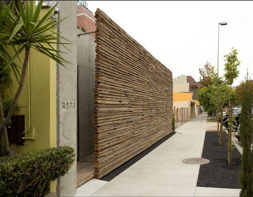 Love this stacked wood wall. This totally hip garden by Sebastian Mariscal is located in Tijuana, Mexico