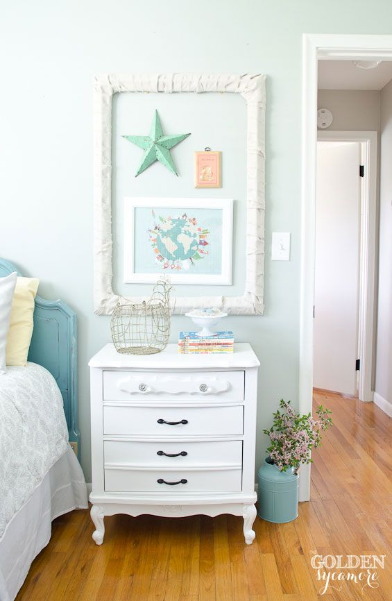 Trash to treasure mini gallery wall and white end table in cottage style little girl's room