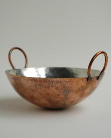 Tin-Lined Copper Hand-Hammered Wok. Breathtakingly beautiful but possibly not so practical as tin will melt if you turn the heat up too high as you do in wok cookery.