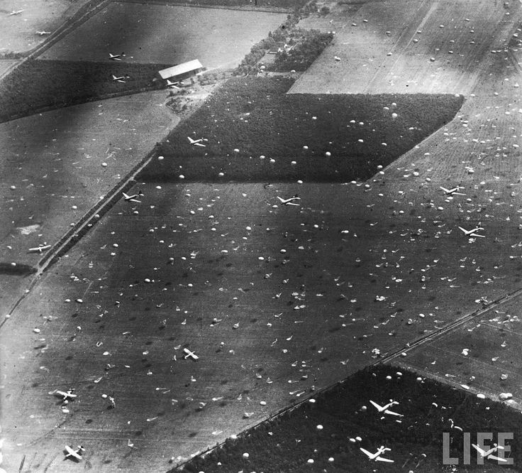 Operation MARKET I: the airborne operation to seize bridges between Arnhem and Eindhoven, Holland, (part of Operation MARKET GARDEN). Oblique photographic-reconnaissance aerial showing Douglas Dakotas dropping paratroops of 1st Airborne Brigade on to Dropping Zone (DZ) 'X', at Renkum, west of Arnhem.