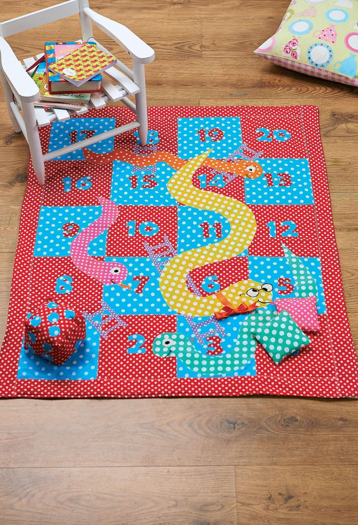 The classic children's board game receives a new lease of life as a playmat, in a whirl of colourful dots! Instructions for game pieces and an oversized dice are included, and with the soft fleece backing it makes a cosy blanket too.
