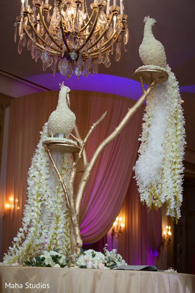Unique Pakistani wedding reception floral peacocks . http://www.maharaniweddings.com/gallery/photo/116205