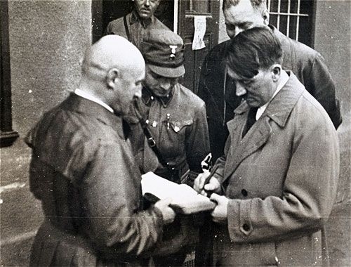 Hitler signs book for Streicher | USHMM Artifact Gallery