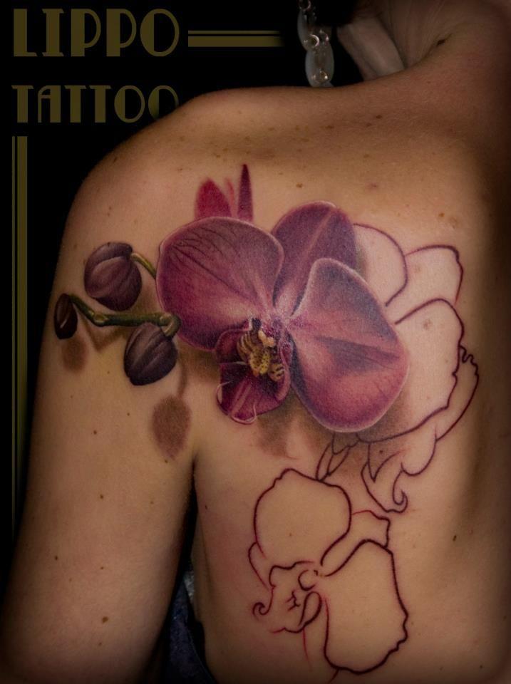 Orchid Tattoo in progress by Lippo Tattoo in Frosinone, Italy