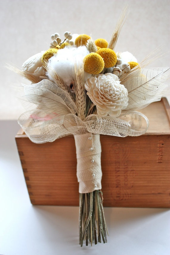 Cotton bolls and dried craspedia together.....LOVE  (Plus, it won't die and be thrown away after the wedding)