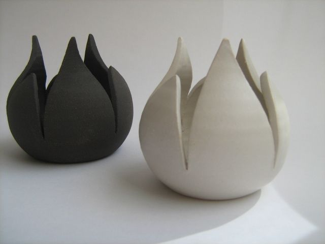 Tea-light holders : Tulips.They are made by black&white stoneware.1260C.  Tea-light candles can be placed inside them. Colour : black...