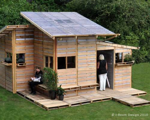 Lil Pallet House - made with used pallets! Great idea for garden sheds and dog houses too! From i-beamdesign.com.