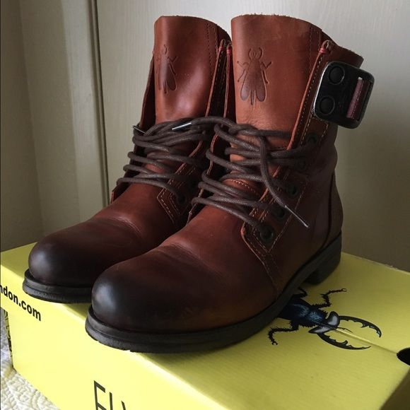 """Shop Women's Fly London Brown size 7 Combat & Moto Boots at a discounted price at Poshmark. Description: 🚫NO TRADES🚫 ✨PRICE IS FIRM✨  Super sturdy but soft leather boots! They are in excellent condition, only worn a couple times. Very minor signs of wear. Made from amazing quality. Fits like a true 7 🙌  *Details taken from Nordstrom & are available for $289.95* Smooth, polished leather and a rugged webbedbelt define the utilitarian vibe of a definitive casual boot. * 1"""" h..."""