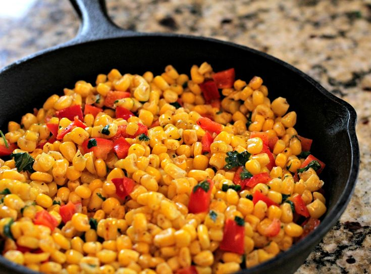 Skillet Corn Salad - the perfect side dish with Mexican or Southwestern food!  Corn, red bell pepper, cilantro, lime juice, and salt/pepper.  It's that simple.