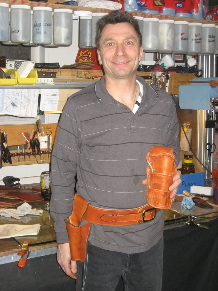 My latest student Stan Garchinski! Stan is an experienced leather worker, which allowed us to cover steel liners and some other advanced techniques. He'll finish those edges at home! ;o})> www.slickbald.com #holsterschool #leather #holster #student