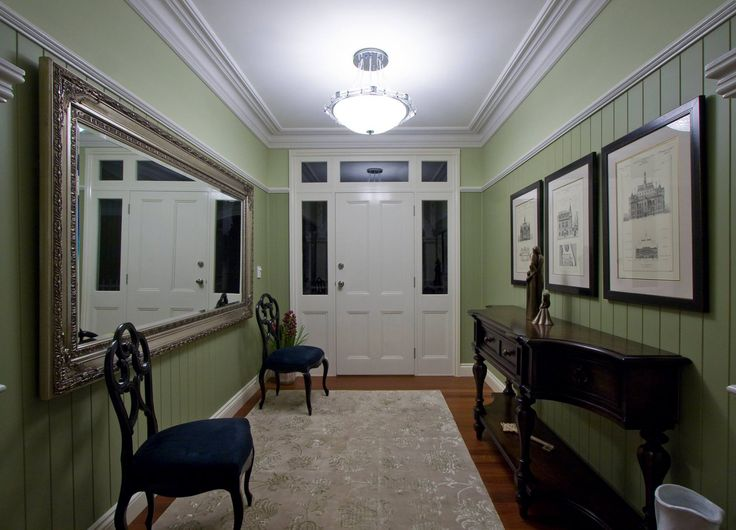Internally, the [American/Cape Cod style] homes are full of detail that is aesthetically pleasing. These include wide timber mouldings around doorways and windows, infill wall panels up to a chair rail [and] interesting light fittings, including wall lights.