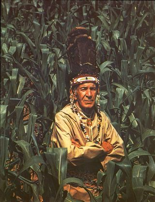 Chief William Miles standing in a cornfield on the Pamunkey reservation, ca. 1980s