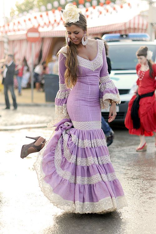 I need a dress like this for Feria this spring! Gotta love Spain! Too bad they are mad expensive...