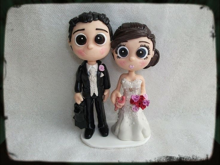 Boogiebabys Cake Toppers: Novelty Cake Toppers with the Groom holding diving fins and the bride holding a conch shell. These are just one pair of the latest #weddingtoppers created here. Please come and check out our bargain prices #noveltycaketoppers