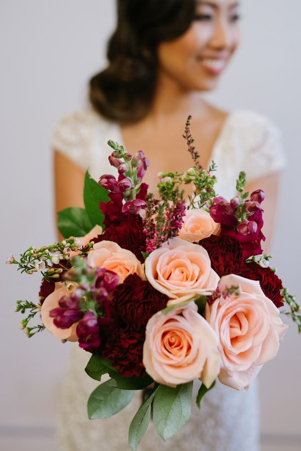 burgundy peach bouquet - photo by GreenAutumn Photography and Film http://ruffledblog.com/wedding-style-meets-the-big-easy