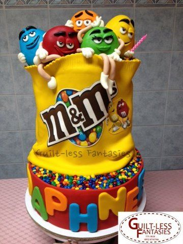 m's #Cake We love how the little m guys and girls are popping out of the bag! Super cake! Great #CakeDecorating We love and had to share!