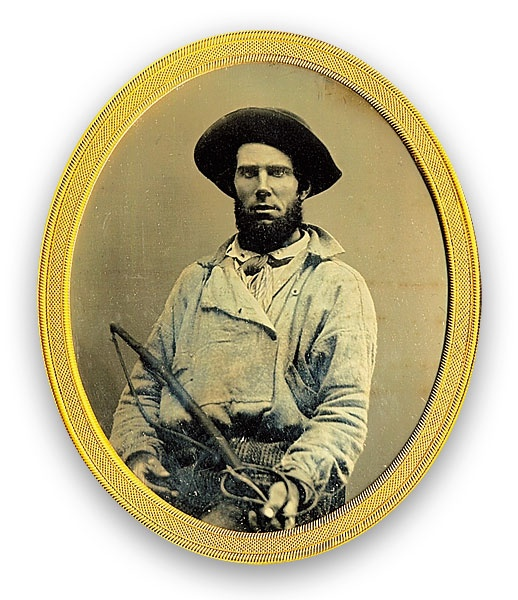 A bullwhacker with his whip, circa 1850s. These were the men and sometimes women who walk alongside the freight wagons cracking bullwhips to keep the yoked oxen moving, made camp every evening to feed, water and rest themselves and their beasts.