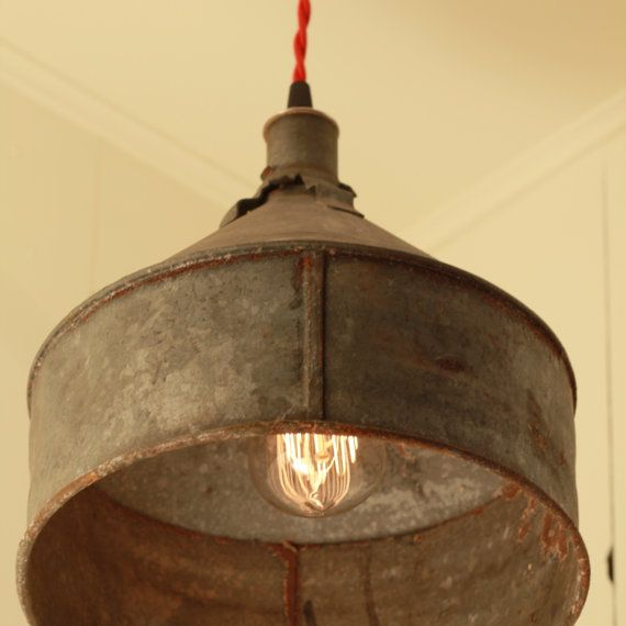 Large old funnel repurposed as a hanging light fixture ~ already did this in my laundry room
