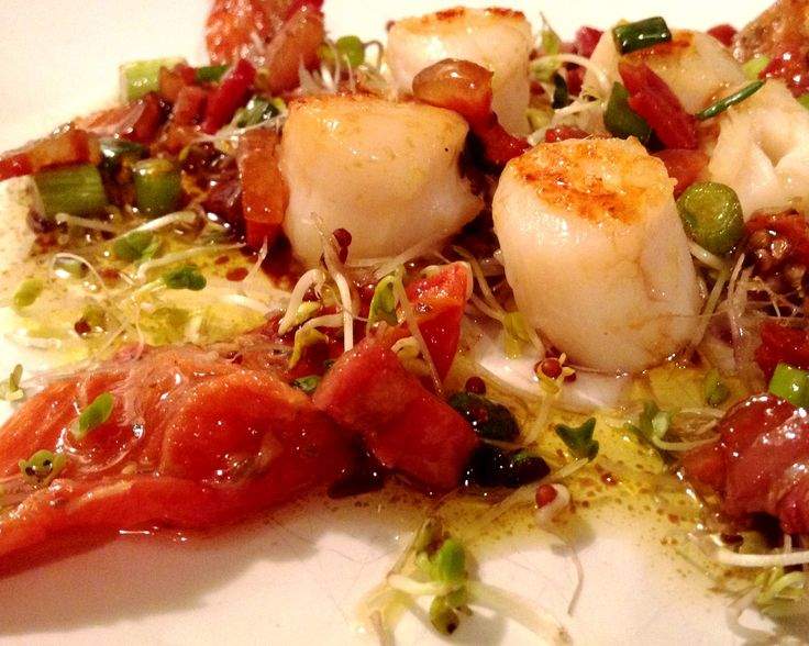 Amazing seared scallops with oven roasted tomatoes and a pancetta dressing.  Make it as an appetizer, main dish, or holiday potluck.