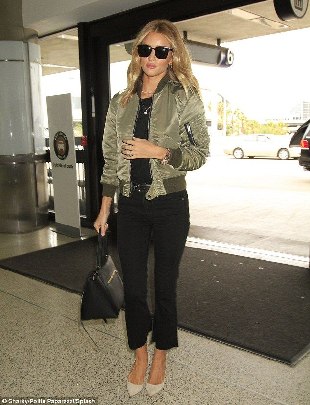 Catwalk to (airport) runway ready! Rosie Huntington-Whiteley looks jet-set stunning in snug jeans and a silky green bomber jacket at LAX   Daily Mail Online