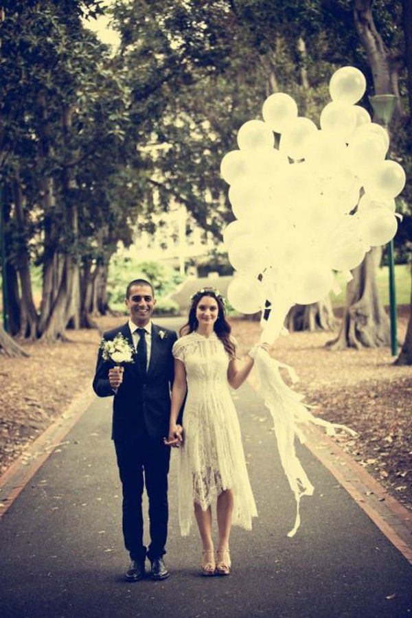 Balloon wedding bouquet......Opt for a gorgeous white balloon arrangement in your photos in lieu of a traditional wedding bouquet.