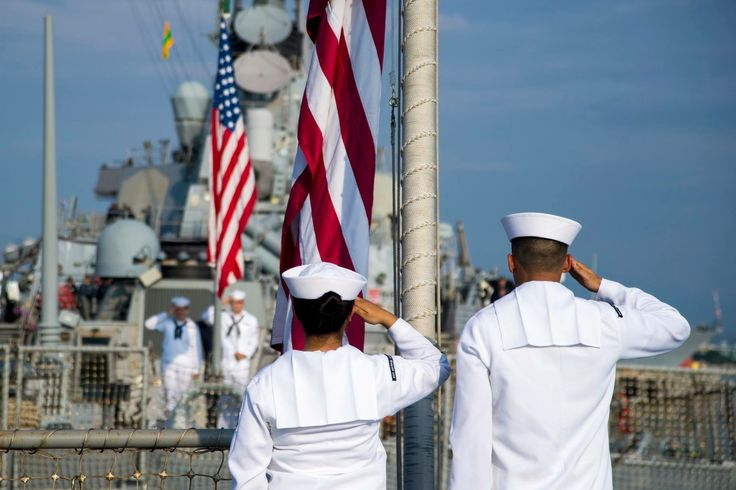 Sailors aboard USS Michael Murphy (DDG 112) and USS O'Kane (DDG 77) salute as the national ensign flies at half-mast aboard their ships today at Pearl Harbor. President Trump ordered the U.S. flag to be flown at half-staff until sunset Friday in honor of the victims of the mass shooting in Las Vegas.