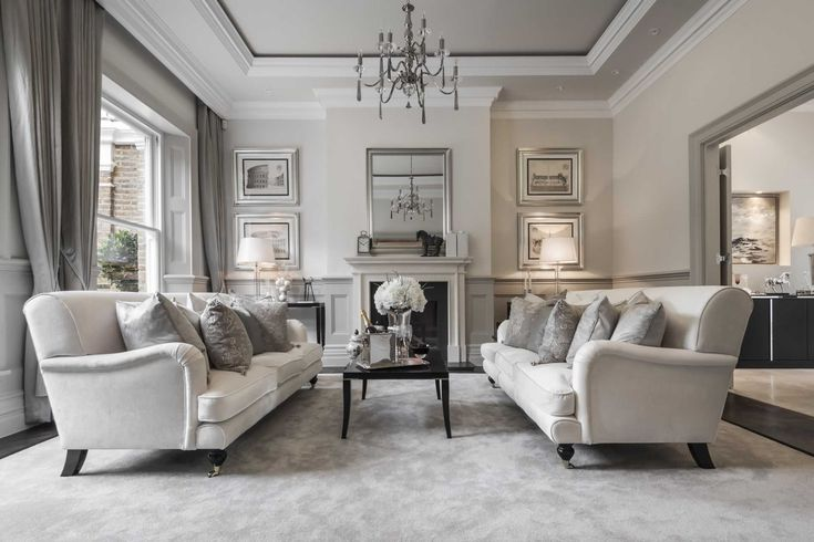 A charming and traditional Georgian style town house which features ebony wood and antique silver, designed by Alexander James Interiors.