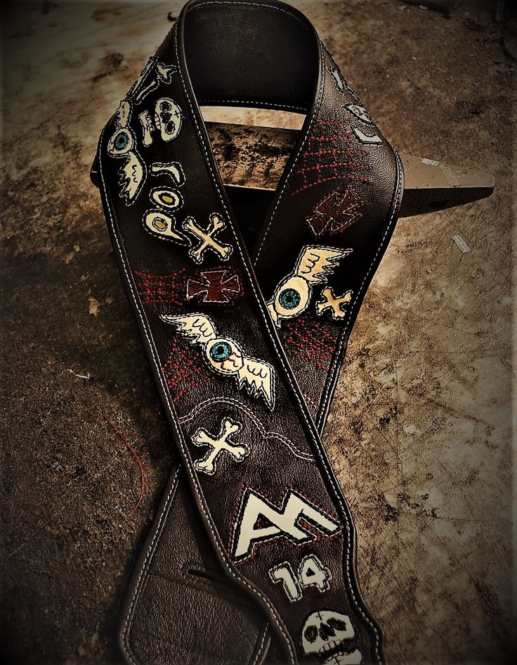 One-of-a-kind high end custom guitar strap I designed for client, Rat Rod guitar strap with lots of detailed stitching and artwork. Not mass produced. www.eddiebratleather.com